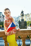 happy woman with Czech flag on Wenceslas Square blowing air kiss