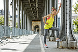 woman jogger relaxing after workout on Pont de Bir-Hakeim bridge