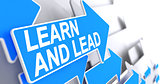 Learn And Lead - Text on Blue Arrow. 3D.