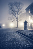 Evening foggy street of old european town