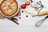 Apple Pie with Ingredients Over Wooden Table Top