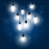 Luminous light bulbs hanging on cords - lamps