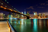 Brooklyn Bridge over East River night in New York City
