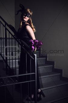 beautiful girl in black mask
