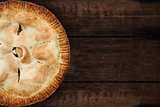 Apple Pie Over a Dark Wooden Table Top