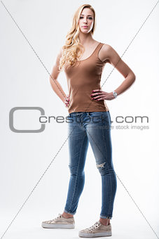 blue jeans and brown underskirt woman