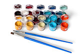 Set of colorful acrylic paints in jars and two brushes
