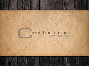 old dark wood background with paper