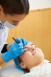 Permanent make-up wizard makes eyebrow correction procedure.
