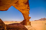 Stone arch over the Wadi Rum desert in Jordan