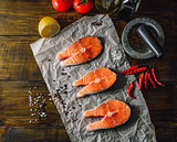 Three Raw Salmon Steaks with Spices