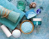 Spa concept turquoise - soap, salt, cream, towel