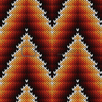 Knitted seamless pattern in warm hues