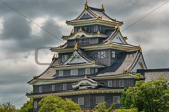 Okayama castle against dark clouds, Japan