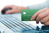 Man holding green payment card