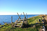 Coastal stile by a footpath