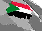 Sudan on globe with flag