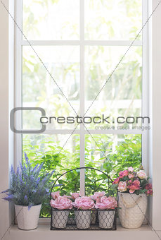 Artificial flowers on the window