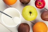 healthy breakfast - yogurt cup with fruits. top view