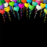 Colorful heart balloons on ribbons over black background