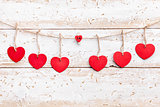Love concept. Hearts hanging on a string