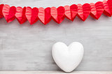 Love concept. Hearts hanging on grey background
