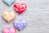 Love concept. Colorful hearts on grey background