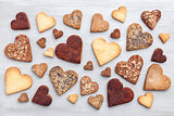 Love concept. Variety of heart cookies on grey background