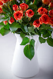 Big Bouquet of fresh Red Roses on a white background.