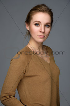 Beautiful girl isolated over grey background