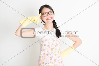 Housewife thinking and smile