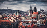 High spires towers of Tyn church in Prague city
