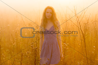 Beautiful girl in fog