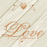 Love text and floreal heart on wood background