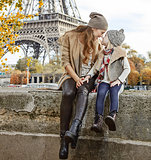 mother and daughter travellers sitting on the parapet in Paris