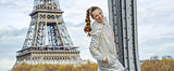 happy young fitness woman against Eiffel tower in Paris