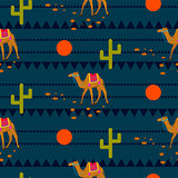 Desert camels on ethnic night blue pattern.