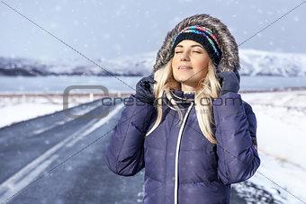 Beautiful girl enjoyong winter