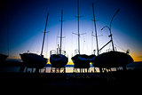 Sailboats at dry dock sunrise view