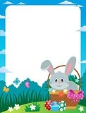 Frame with Easter bunny in basket