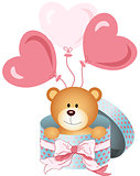 Teddy bear in round gift box with bow ribbon and balloons