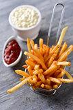 french fries, mayonnaise and ketchup