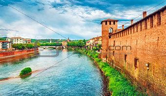 Bridge with archs Castelvecchio over river Adige