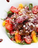 Warm salad with chicken liver in raspberry sauce