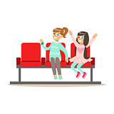 Two Girls Waiting Taking Seats In Cinema Room, Part Of Happy People In Movie Theatre Series
