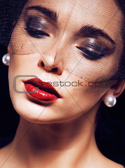 beauty brunette woman under black veil with red manicure close u
