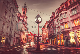 Czech Republic Prague square with old street lamp with clock