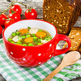 bouillon with vegetables, chicken, dill and parsley