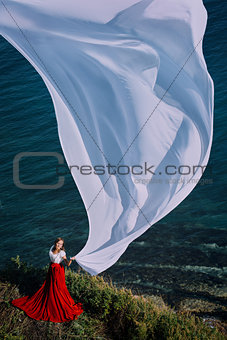 Beautiful Girl With White fabric on sea background