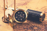 compass and nautical vintage equipment on old world map